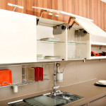 Modern kitchen design containing a sink, furniture, appliances and accessories.